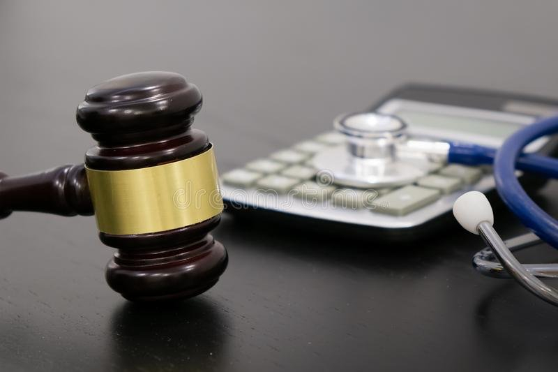 Wooden Judge Gavel With Drugs On Table. Space For Text Open Med Expiration Date Calculator